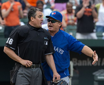 John Gibbons arguing with umpire Mike DiMuro. He returned as the Blue Jays manager prior to the start of the 2013 season. Mike DiMuro and John Gibbons in 2013 (8679776768).jpg