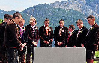 Moment of silence - A moment of silence observed by people wearing the traditional folk costumes of the Gail Valley in Austria.