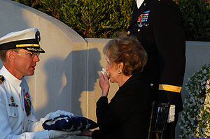 James Symonds - Captain Symonds presents the flag that draped President Ronald Reagan's casket to former first lady Nancy Reagan, June 11, 2004