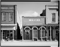 NORTH FRONT AND PORTIONS OF EAST AND WEST ADJACENT BUILDINGS - Plains Bank, Main Street, Plains, Sumter County, GA HABS GA,131-PLAIN,13-1.tif