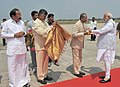 Narendra Modi being welcomed on arrival by the Governor of Andhra Pradesh and Telangana, Shri E.S.L. Narasimhan, the Union Minister for Urban Development, Housing and Urban Poverty Alleviation and Parliamentary Affairs.jpg