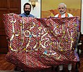"Narendra Modi handing over the ""Chaadar"" to be offered at Dargah of Khwaja Moinuddin Chishti, Ajmer Sharif, to the Minister of State for Minority Affairs and Parliamentary Affairs, Shri Mukhtar Abbas Naqvi, in New Delhi.jpg"