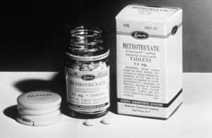 Image shows open bottle of methotrexate drug -...