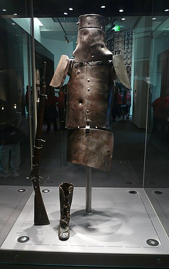 Armour of the Kelly gang - Ned Kelly's armour on display in the State Library of Victoria. The helmet, breastplate, backplate and shoulder plates show a total of 18 bullet marks. Also on display are Kelly's Snider Enfield rifle and one of his boots.