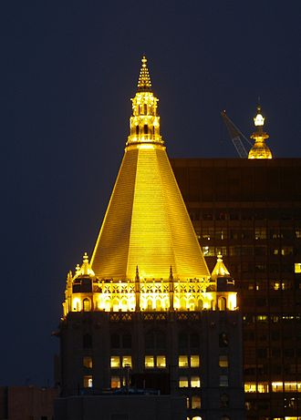 Rose Hill, Manhattan - The gold top of the New York Life Building illuminated at night