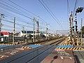 Nishitetsu Tenjin-Omuta Line and Kagoshima Main Line near Nishitetsu-Ginsui Station.jpg