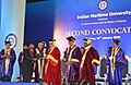 Nitin Gadkari presenting the graduation certificate to a student of India Maritime University at the Second Convocation Day Celebration of Indian Maritime University (1).jpg