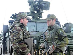 Nordic Battlegroup - Soldiers of the Irish and Swedish militaries wielding a Steyr AUG and an Ak 5, respectively
