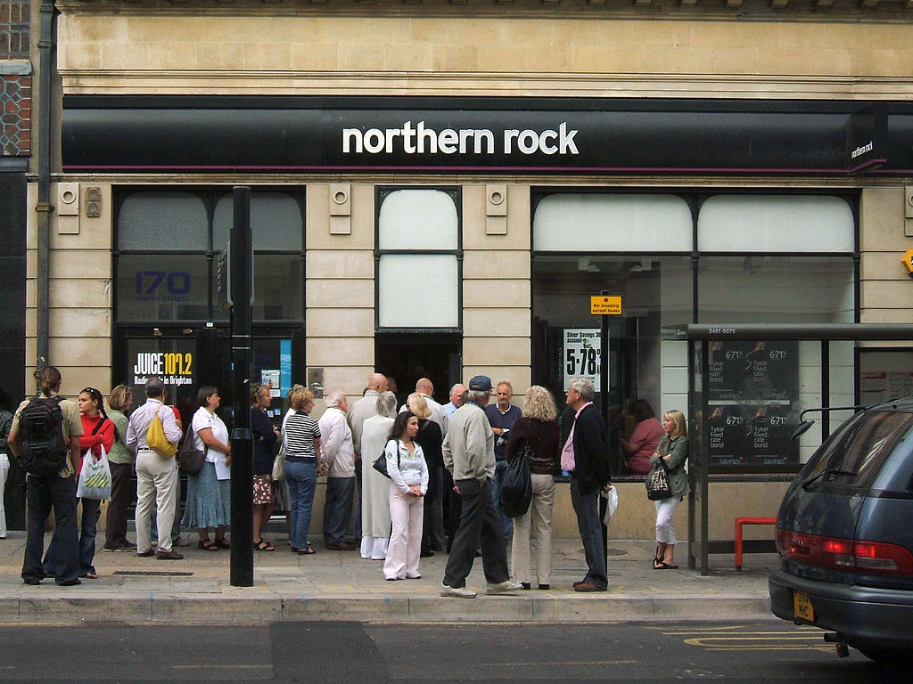 A number of people queuing at the door of a branch of the Northern Rock bank.