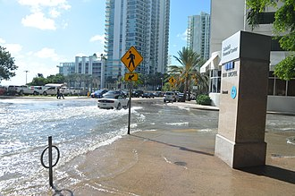 "Tidal flooding - October 17, 2016 tidal flooding on a sunny day during the ""king tides"" in Brickell, Miami that peaked at four feet MLLW."