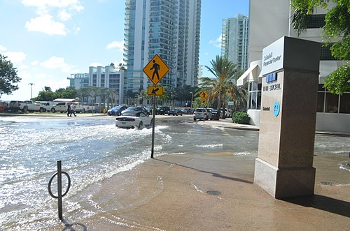 "October 17, 2016 tidal flooding on a sunny day, during the ""king tides"" in Brickell, Miami that peaked at 4 ft MLLW. October 17 2016 sunny day tidal flooding at Brickell Bay Drive and 12 Street downtown Miami, 4.34 MLLW high tide am.jpg"