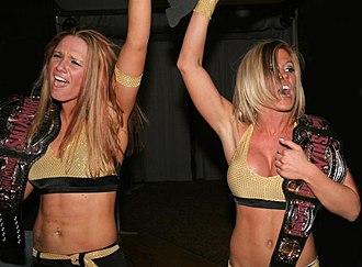Madison Rayne - Lane (right) with Nevaeh as the Shimmer Tag Team Champions