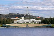 Old and new parliament houses across lake crop.jpg