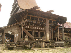 Rumah adat - Traditional house in Nias; its post, beam and lintel construction with flexible nail-less joints, and non-load bearing walls are typical of rumah adat