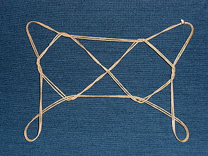 "String figure - ""Osage Two Diamonds""."