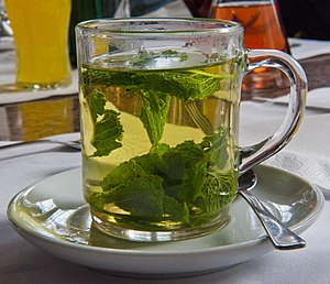 Peppermint tea with fresh leaves