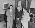 Photograph of President Truman in the Oval Office with two members of the Amputee Demonstration Team of the American... - NARA - 200307.tif