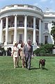 Photograph of President William Jefferson Clinton, First Lady Hillary Rodham Clinton, Chelsea Clinton, and Buddy the Dog Walking on the South Lawn- 07-24-1998 (6461537945).jpg