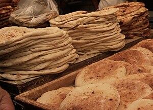 English: Stacks of pita for sale, Mahane Yehud...