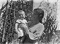 Portrait of woman holding baby (AM 79626-1).jpg