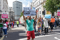 Pride in London 2016 - A queer Muslim holding a rhyming sign.png