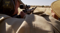 Professional hunter with client taking aim Namibia 01.png