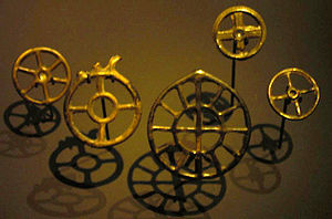 Sun cross - Wheel pendants dating to the second half of the 2nd millennium BC, found in Zürich, are held at the Swiss National Museum. Variants include a six-spoked wheel, a central empty circle, and a second circle with twelve spokes surrounding one of four spokes.