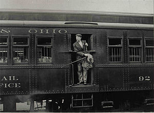 Catcher pouch - Post Office Clerk in mail car ready to make an outgoing-incoming exchange