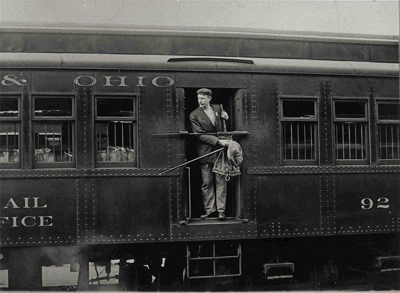 File:Railway Post Office Clerk in Mail Car.jpg