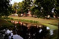 Reflection of Jelgava palace in canal - panoramio.jpg