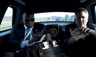 Body man - Reggie Love, left, Barack Obama's body man from 2009 to 2011, is seen here in a presidential motorcade outside Strasbourg for the NATO Summit, April 2009