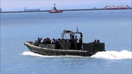 File:Riverine Patrol Boats (RPB) Guarding the HMAS Adelaide.webm