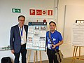 Robin Owain and Inaki Luzuria, with Poster by Wikimedia Levant Members at Palestine, at EduWiki 2019 Conference.jpg