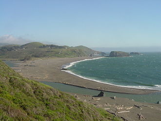 Sonoma County, California - Goat Rock Beach as viewed from the Jenner Cliffs looking south, showing the mouth of the Russian River at the Pacific Ocean.