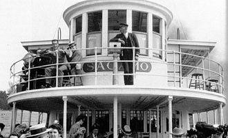 SS Sagamo - Pilothouse of the Sagamo on her first season in 1907 with Commodore Bailey on the bridge