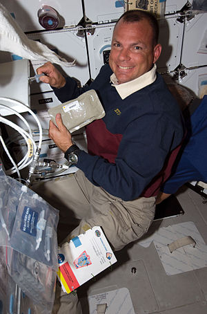 Dominic A. Antonelli - Antonelli preparing to eat during STS-119.