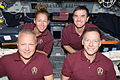 STS-135 crew members on the flight deck.jpg