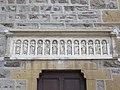 Saint-Pierre-la-Palud - Église Saint-Pierre (entrée latérale, frise).jpg