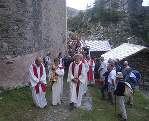 Saint Bessus - Photo of the traditional St Bessus procession that takes place every year in the Alps near Campiglia, Turin, Italy.