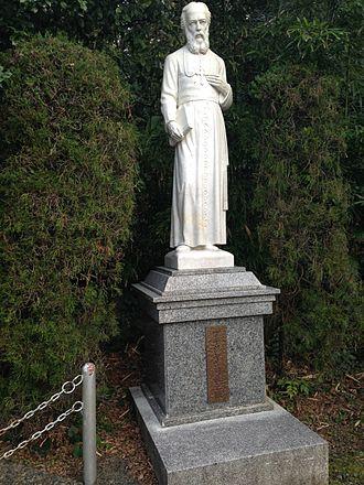 Bernard Petitjean - Sculpture of Petitjean in the garden of the Church of the Twenty-Six Martyrs.