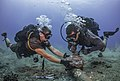 Seabees remove corroded zinc anodes from an undersea cable. (28073762161).jpg