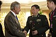 Secretary of Defense Chuck Hagel speaks with Chinese Lieutenant General Qi Jianguo.jpg