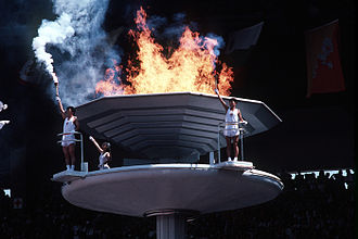 1988 Summer Olympics - South Koreans stand next to the 1988 Summer Olympic cauldron
