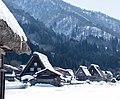 Shirakawago village and snowy mountain (13087582315).jpg