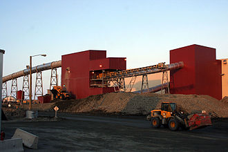 Snap Lake Diamond Mine - Two loaders work outside the ore processing and recovery plant.
