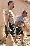 Soldiers fill sandbags for exercise DVIDS300655.jpg