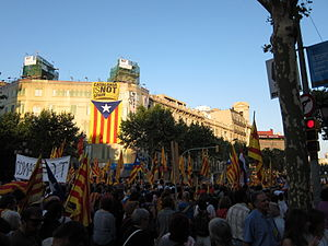 2010 Catalan autonomy protest - People deploy a large Estelada flag and the slogan in English Catalonia is not Spain during the demonstration.
