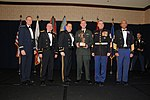 Specialist Kevin Cox, CSMR, poses with Soldier of the Year award.jpg