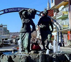 Statue of young women harvesting grapes at Bekilli main square