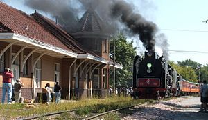 Excursion train - A steam-powered excursion train stops at the Chicago, Rock Island and Pacific Railroad Passenger Station in Iowa City, Iowa in 2006